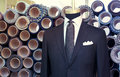 Suite on the mannequin men's a with fabric rolls in background Royalty Free Stock Images