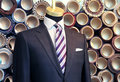 Suite on a mannequin men's with fabric rolls in the background Stock Photography