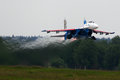 Sukhoi Su-27 of Aerobatics team Russian Knights jet fighter takes off at Kubinka air force base during Army-2015 forum Royalty Free Stock Photo