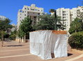 Sukkoth in tel aviv a sukkah is a temporary hut constructed for use during the week long jewish festival of sukkot it is topped Stock Photography