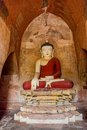 Sulamani temple old renovated sculpture of a seated buddha inside of in bagan myanmar Stock Photography