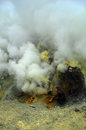 Sulfur mining at the crater of activ voulcan Ijen, Indonesia Royalty Free Stock Photo