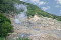 Sulfur springs steam rises from a vent in the of st lucia Royalty Free Stock Images