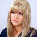 Sulking girl cute blond with expression Stock Images