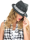 Sulky sultry young fashionable woman wearing black tilbury hat isolated white background Royalty Free Stock Images