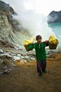 A sulpher miner of ijen volcano ijen indonesia the miners Royalty Free Stock Images
