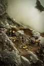 Sulpher miners of ijen volcano ijen indonesia the Stock Photo