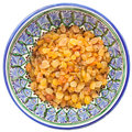 Sultana raisin in traditional central asian bowl Stock Images