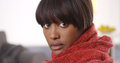 Sultry black woman wearing red blanket Royalty Free Stock Photos
