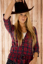 Sultry blond model wearing a cowboy hat barnwood background attractive Royalty Free Stock Photos