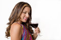 A sultry brunette with a glass of red wine in bright dress Royalty Free Stock Photography
