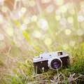 Summer backgound with retro camera and bokeh Stock Photography
