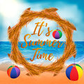Summer background of beach and sea elements with dried wreath, beach balls and text