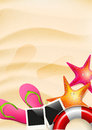 Summer background with copyspace sand flip flops seastar and safety circle Royalty Free Stock Images