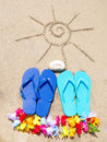 Summer background with flip flops decoration and rock sign love on the sandy beach Stock Photos
