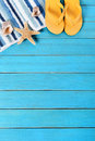 Summer beach background border, starfish, flipflops, blue wood, vertical Royalty Free Stock Photo