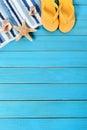 Summer beach background border, starfish, flipflops, blue wood, vertical Royalty Free Stock Photo