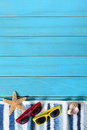 Summer beach background border, sunglasses, towel, starfish, blue copy space, vertical Royalty Free Stock Photo