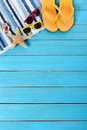 Summer beach background, sunglasses, flip flops, starfish, copy space, vertical Royalty Free Stock Photo