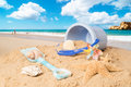 Summer beach with bucket spade and seashells Royalty Free Stock Photography