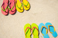 Summer beach four pairs of sandals on white sand Stock Photography