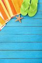 Summer beach objects vertical border, flip flops, copy space Royalty Free Stock Photo