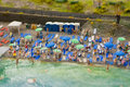 Summer beach resting people on the miniature Royalty Free Stock Photos