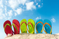 Summer beach row of colorful flip flops on against sunny sky Stock Photography