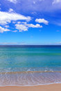Summer Beach Scene with turquoise water and blue sky Royalty Free Stock Photo