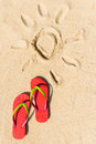 Summer beach theme with red flip flop on sandy Stock Photo