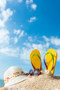 Summer beach vacation concept with flip flop sunglasses and floppy hat Stock Photos