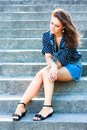 Summer beautiful girl portrait pretty young caucasian depressed woman sitting on staircase Stock Photo