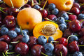 Summer berries and fruits: sweet cherries, blueberries and apricots Royalty Free Stock Photo