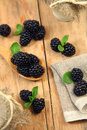 Summer berry sweet blackberry on wooden table Stock Photos