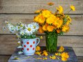 Summer bright bouquets, orange calendula and white daisy Royalty Free Stock Photo