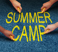 Summer camp with multiple ethnic school kids drawing words on a pavement outdoor floor as a symbol of recreation and fun education Royalty Free Stock Photo