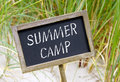 Summer camp on sign Royalty Free Stock Photo