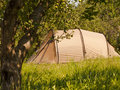 Summer camping tourist tent in green forest Royalty Free Stock Image
