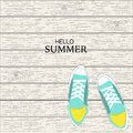 Summer canvas shoes with wood linear background