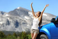 Summer car travel freedom woman in yosemite national park with arms raised up cheerful and happy summer road trip traveler concept Stock Photos