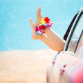 Summer car trip woman legs against blue sea and beach background vacations concept Stock Images