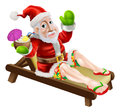 Summer christmas santa claus on a hot holiday relaxing in a sun lounger on the beach or by the pool wearing bermuda or hawaiian Royalty Free Stock Photography