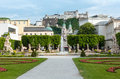Summer city garden salzburg austria gardens of mirabell palace with flowerbeds fountain and statues and hohensalzburg fortress Royalty Free Stock Image