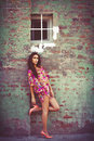 Summer in the city woman colorful dress lean on wall outdoor shot day Stock Image