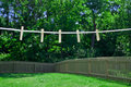 Summer clothes line hanging in backyard Stock Photos