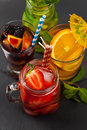 Summer cocktails and drinks with fruits pieces selective focus Stock Image