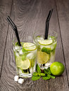 Summer cold cocktail drink mojito on dark background Stock Photo