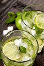 Summer cold cocktail drink mojito on dark background Royalty Free Stock Images