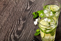 Summer cold cocktail drink mojito on dark background Stock Photos