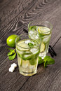 Summer cold cocktail drink mojito on dark background Stock Images